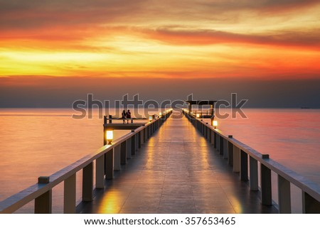 Sweetheart on Wooded bridge with sunset, background for Valentine day - stock photo