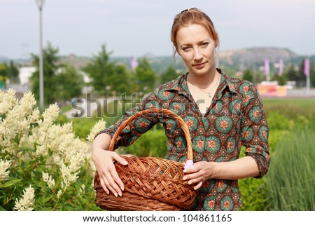 sweetie girl in jeans shorts with basket