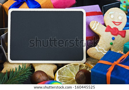 sweets and cakes for Christmas and congratulations to the blackboard - stock photo