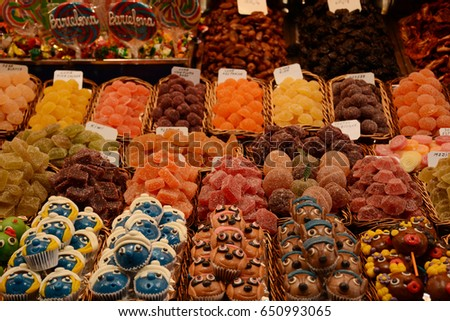 Sweets and marmalade on the counter of the market in Barcelona