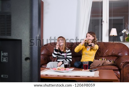 Sweets and tv - stock photo