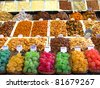 Sweets, candies and dried fruits in La Boqueria (Barcelona famous market) - stock photo
