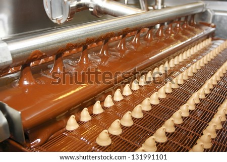 Sweets on a chocolate factory conveyor - stock photo