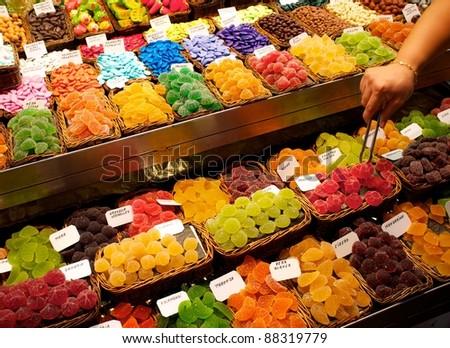 Sweets on market stall in La Boqueria, Barcelona - stock photo