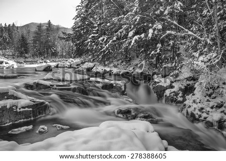 Swift River Rocky Gorge in New Hampshire.  Shot taken in winter. Long exposure used. - stock photo