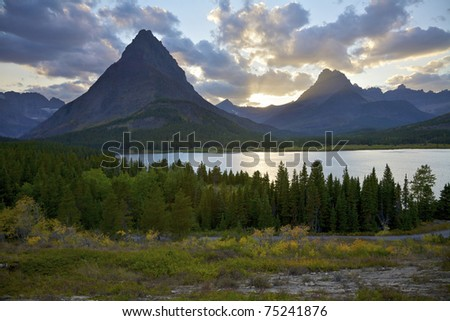 Swiftcurrent Lake and Mount Grinnell at Sunet, Glacier National Park, Montana, United States. - stock photo