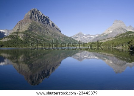 Swiftcurrent Lake and reflection in Glacier National Park, Montana - stock photo