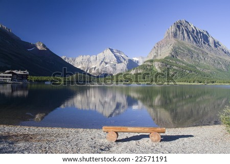 Swiftcurrent Lake, mountains, and reflection in Glacier National Park - stock photo