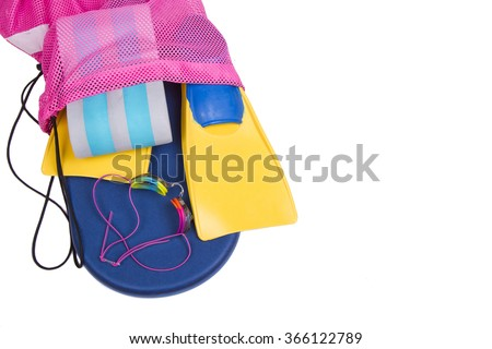 Swim fins, kick board, pull buoy and goggles spilling out of a bag on a isolated white background for high school swim team background or competitive swim teams. Top view. - stock photo