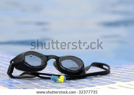 swiming glasses at the pool - stock photo
