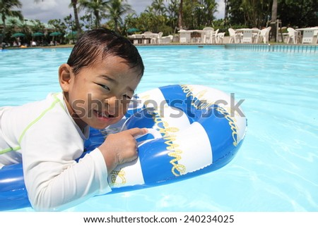 Swiming Japanese boy (2 years old) - stock photo