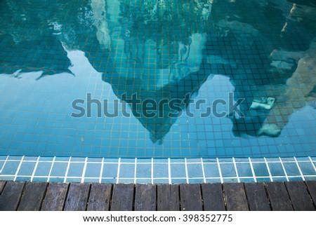 Swiming pool and reflection - stock photo