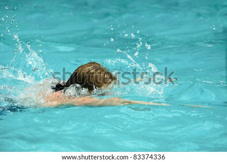 swimmer face down in a swimming pool