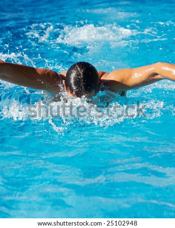 Swimmer in a swimming pool of clear water