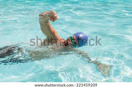 swimmer in action. Free style swimming - stock photo
