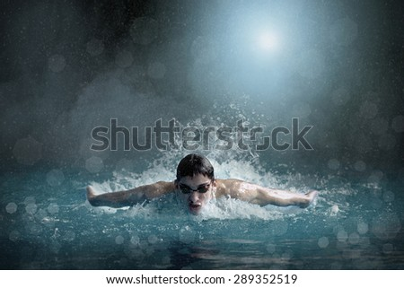 Swimmer in open waterpool, swim one of swimming style. - stock photo