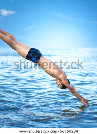 Swimmer jumping to sea water. - stock photo