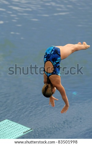 Swimmer launched into water in a diving competition - stock photo