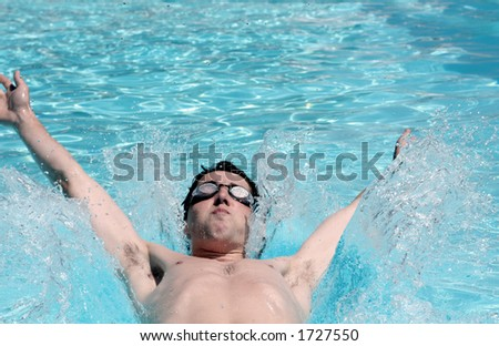 swimmer on his back - stock photo