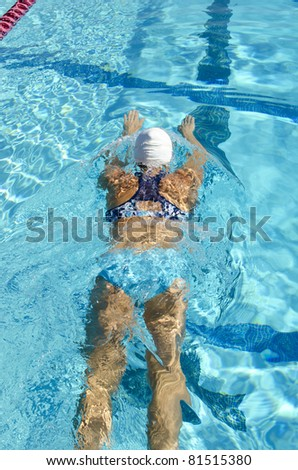 Swimmer practices in the lane of an outdoor aquatic center - stock photo