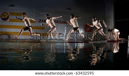 swimmer running on water on swimming pool - stock photo