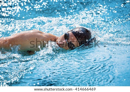 swimmer swimming competition pool. - stock photo