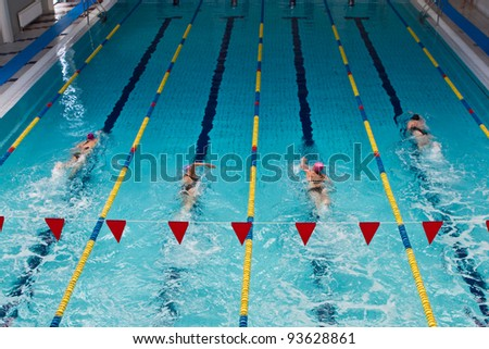 swimmers in indoor pool - stock photo