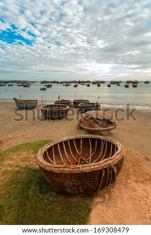 swimming baskets, the boat on a sunset in Asia - stock photo
