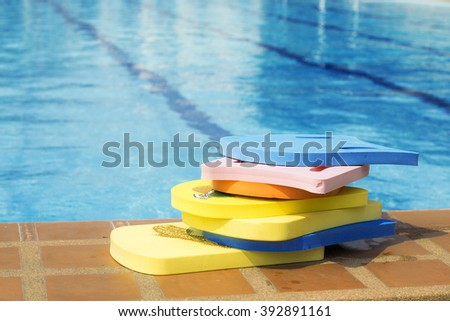 Swimming boards on beside of the pool  - stock photo