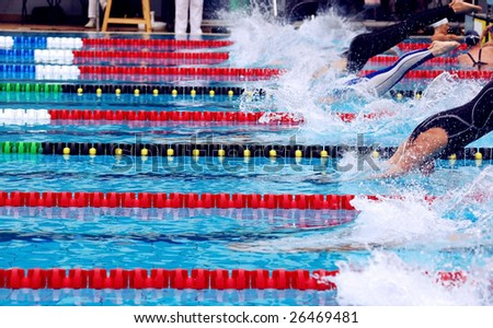 swimming, breaststroke in waterpool with blue water - stock photo