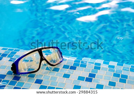 Swimming diving mask in swimming pool - stock photo