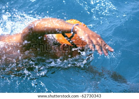 swimming, freestyle in  blue water - stock photo