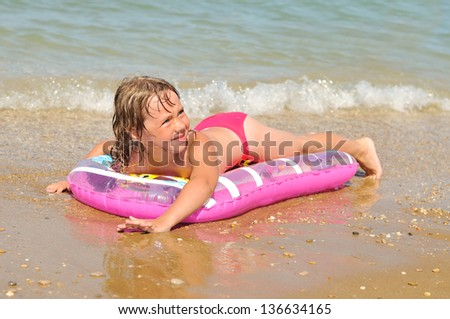 swimming girl on the water-bed - stock photo