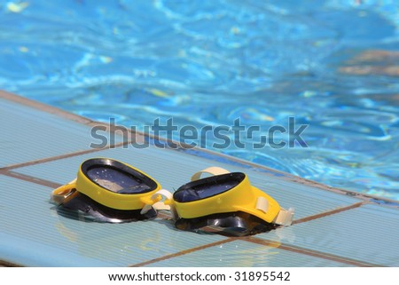 Swimming goggle by the  swimming pool - stock photo