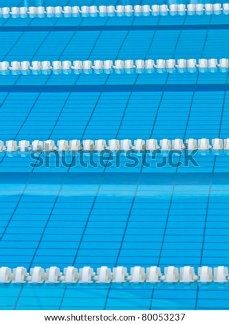 Swimming lanes in an official size swimming pool - stock photo