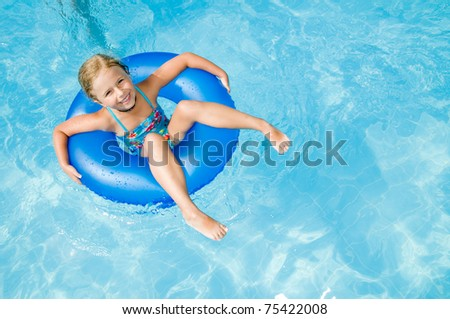 Swimming - little girl playing in swimming pool
