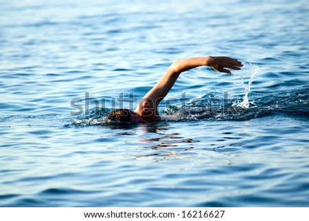 swimming man in ocean water