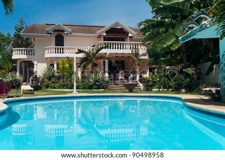 swimming pool and a tropical villa in the Philippines - stock photo