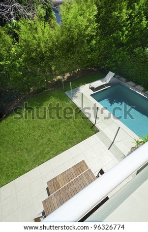Swimming pool and backyard view from balcony