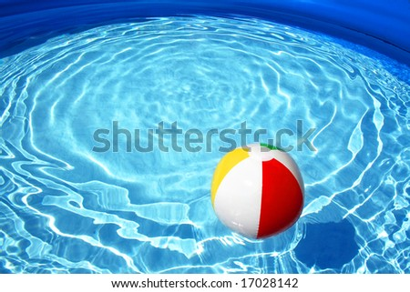 Swimming pool and beach ball - stock photo