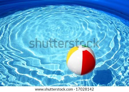 Swimming pool and beach ball - stock photo