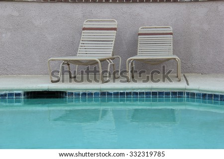Swimming Pool and Chairs for Swimmers