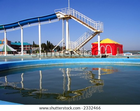 Swimming-pool and childrens  chute on seaside - stock photo