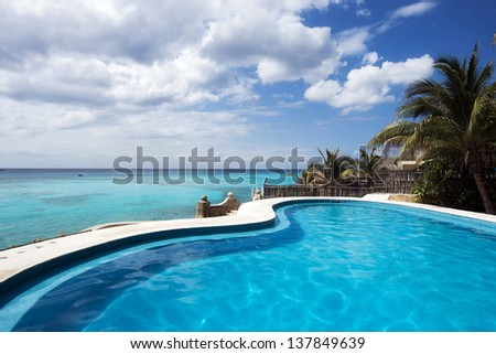 Swimming pool and the turquoise sea in a Caribbean island