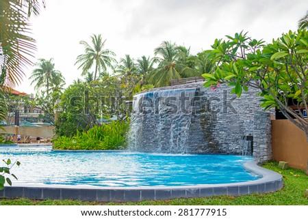 swimming pool and waterfall - stock photo