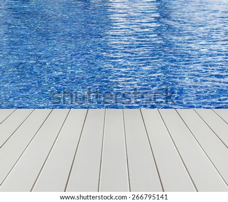 Swimming pool and wooden floor background - stock photo