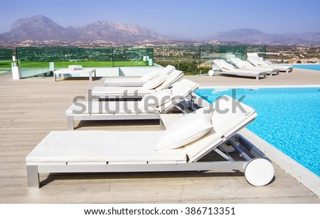 Pool Beds swimming pool area white sun beds stock photo 386713351 - shutterstock