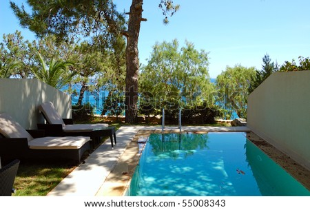Swimming pool at apartment by luxury villa, Crete, Greece - stock photo