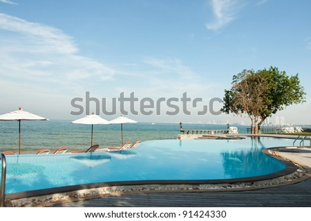 Swimming pool at beach front - stock photo