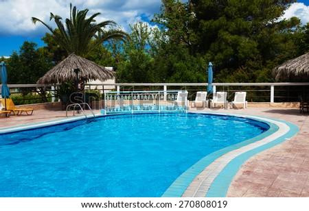 Swimming pool at holiday villa in Greece. - stock photo
